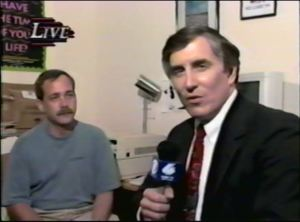 Robb Dussliere and Ken Gullette broadcasting live on WHBF-TV in July, 1995.